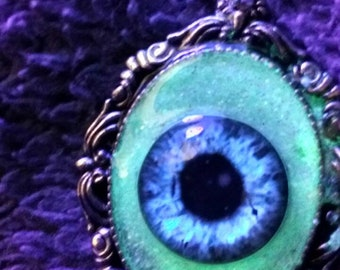 Blue Glow-in-the-dark Eyeball necklace by C 13