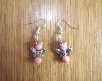 Earrings Peach with a silver metal butterfly.