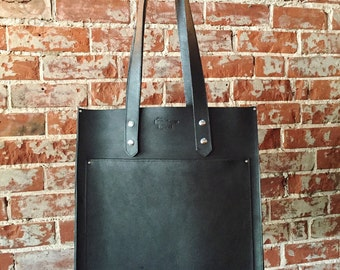 The Pocket Tote  (pictured in black leather)