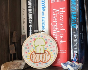 Prickly Prick embroidery, one of a kind original needlepoint bookshelf art (lemon for scale)