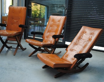 3 leather chairs psychedelic vintage