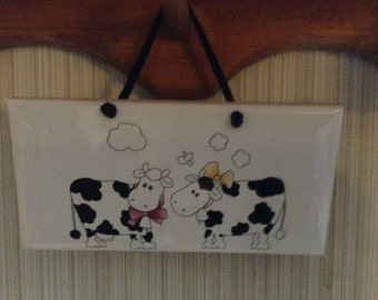 Ceramic Plaque Black and White Cows on  it is 3 by 6