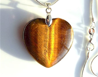 Tiger eye gem stone heart pendant necklace, on snake chain.