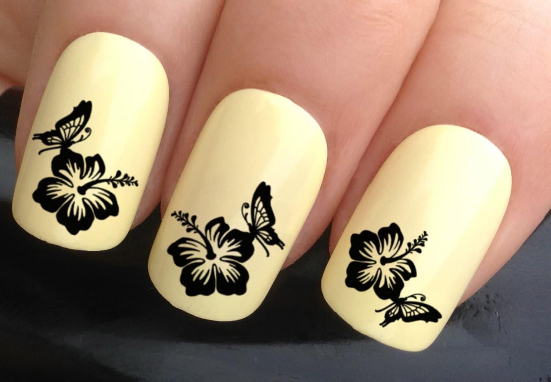 nail art set 632 x24 butterfly landing on black flower water