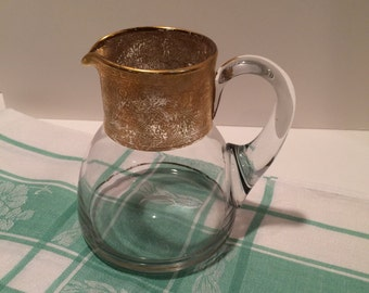 Hand blown drink pitcher with intricate gold overlay