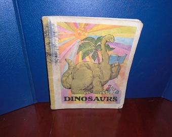 Dinosaur book. Dinosaur schoolbook. vintage schoolbook. dinosaur
