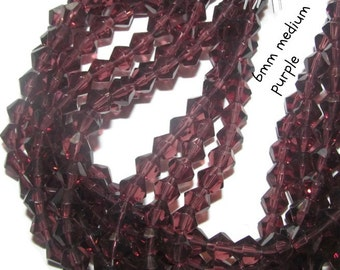 50 - 6mm Glass Bicones -purple / burgundy (071)