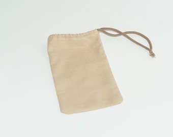 The linen or cotton bag with rope for wood puzzles or toys