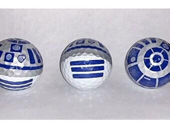 3 white golf balls with R2D2 imprint