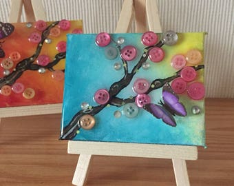 Tiny cherry blossom painting and easel.