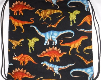 Dinosaurs color on black Backpack/tote made to order