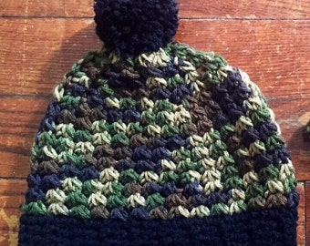 Camoflouge boy hat and with black band and pom