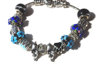 Lovely bracelet made of glass beads, cat paws and little mice.