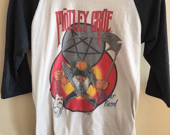"A vintage authentic 1985 Motley Crue ""Theatre of Pain"" 3/4 sleeve concert tee shirt. 1985-1986 World Tour."