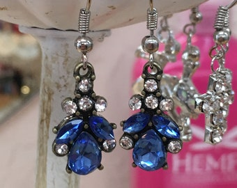 Boho Chic Dazzling Crystal Earrings feature antique brass metal constructions with clear and blue faceted crystals.