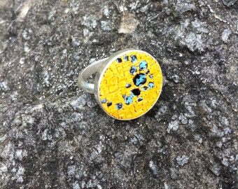unique hand made micromosaic ring with a bright yellow, blue and black design