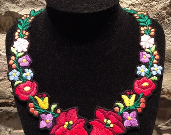 Hungarian Kalocsa embroidered necklace, black or white background. Hand made.