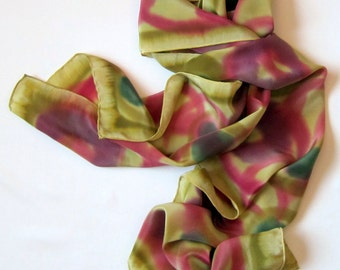 Hand painted silk scarf in rose, bottle green, and violet on chartreuse green.  Scarf painted in cerise,  purple  and  green on chartreuse.