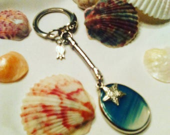 Handmade Blue Sea Glass Keychain with a small silver star and flower
