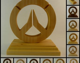 Overwatch logo on a stand. Carved from limewood, beech, cherry and oak