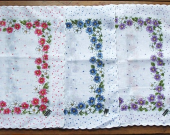 Set of 4 Assorted Colors Floral Design Hankies ~ Matching ~ Never Used ~ Orange ~ Blue ~ Pink ~ Purple ~ White Background ~ Scalloped Edge