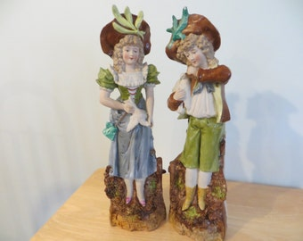 Vintage pair of German bisque figurines couple in phesant costumes