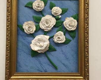 Frame of white roses on blue background