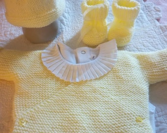 Newborn layette set. Hides heart, hat and booties.