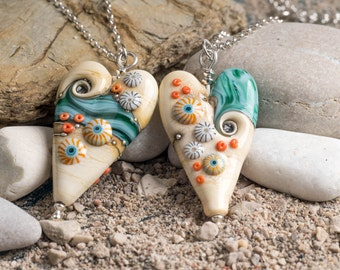 Long Heart in Sand and Sea Design, handmade glass bead pendant, by Beach Art Glass in the UK