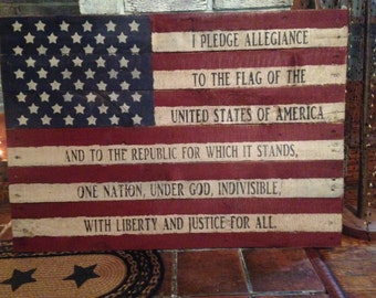 Wooden distressed and aged American flag sign with Pledge of Allegiance