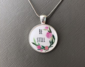 """Be still with flower design 18"""" silver necklace with 1"""" pendant"""