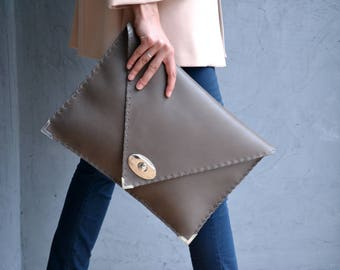 Gray leather clutch