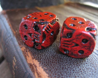Hand cast red skull dice, oogie boogie dice, nightmare movie dice, collectable dice, gaming dice