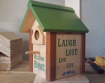 Birdhouse with hand painted uplifting words and designs