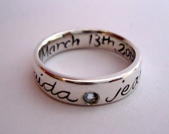 Custom family name ring in sterling silver with birth stone and engraving inside