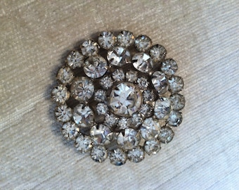 Sparkle in this Clear Glass Rhinestone Circle Vintage Brooch with Silver Metal Base