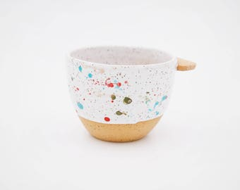 Rainbow splattered speckled white paddle mug
