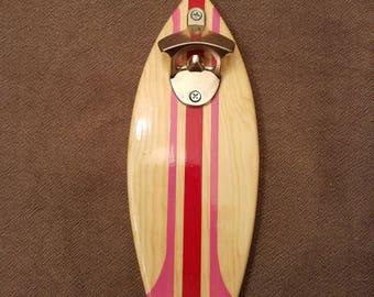 Surfboard bottle opener magnetic cap catch.