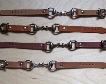 Leather wristband with horse bit and buckle