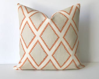 Coral dotted diamond geometric decorative pillow cover