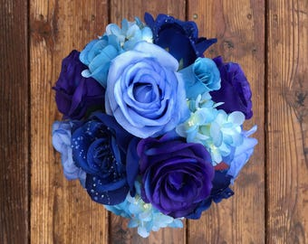Blue and purple rose and blue hydrangea bouquet with matching boutonnière
