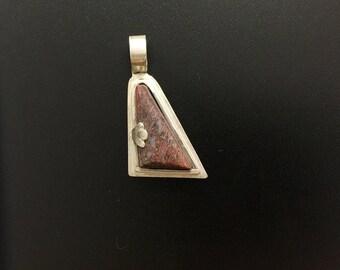 Sterling Silver Pendant featuring a dinosaur bone cabochon
