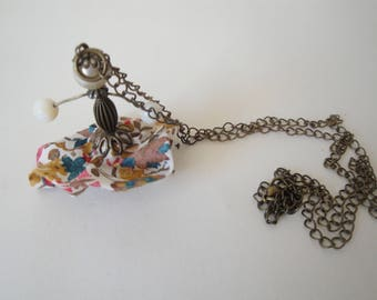 Pendant with liberty character doll