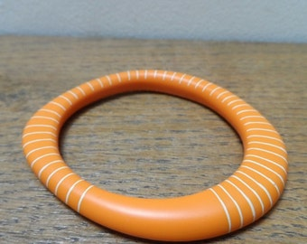 Orange resin wangle bangle with nude stripes
