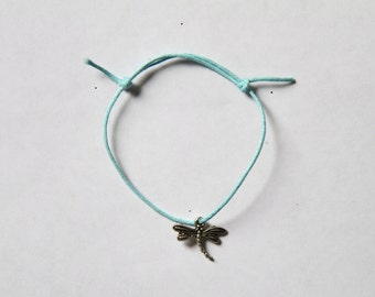 silver dragonfly charm on waxed cotton cord adjustable friendship bracelet