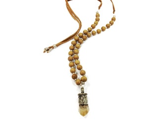 Divine Omen (CITRINE) - a light colored wood and silver necklace on an adjustable brown leather cord with natural raw gemstone pendant