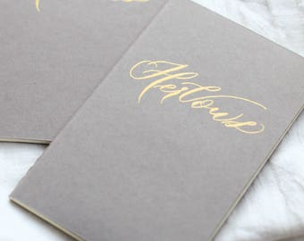 Grey Moleskine Vow books. Gold calligraphy wedding vow book. His and her vow book.