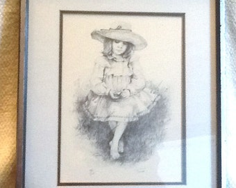 Signed and numbered print of an illustration by American artist Jennie Tomao. Barefoot young girl, straw hat w/flowers. 138/200. Framed.