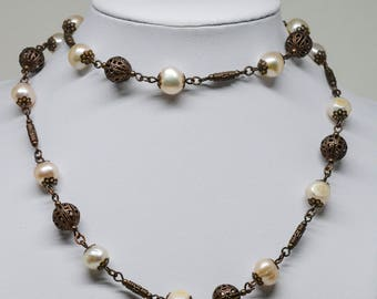 Lovely copper tone and faux pearl beaded necklace