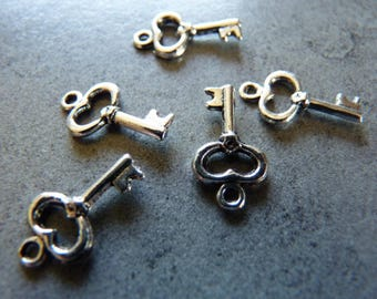 5 key metal charms